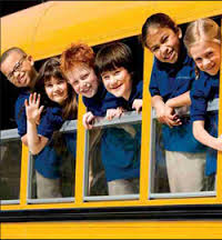 kids leaning out of bus
